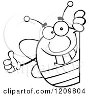 Cartoon Of A Black And White Happy Bee Holding A Thumb Up Around A Sign Royalty Free Vector Clipart