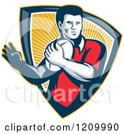 Clipart Of A Retro Rugby Player With A Ball In A Ray Shield Royalty Free Vector Illustration