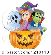 Cartoon Of A Ghost Witch And Vampire In A Halloween Jackolantern Pumpkin Royalty Free Vector Clipart