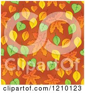 Clipart Of A Seamless Background Of Autumn Leaves On Orange Royalty Free Vector Illustration by visekart