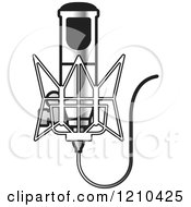 Clipart Of A Retro Silver Microphone And Wire Royalty Free Vector Illustration
