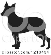 Clipart Of A Black Silhouetted Dog Royalty Free Vector Illustration