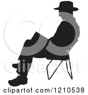 Clipart Of A Black Silhouetted Man Reading In A Folding Chair Royalty Free Vector Illustration
