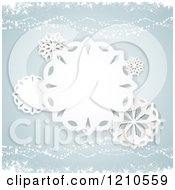 Paper Snowflakes Over Pastel Blue And Waves