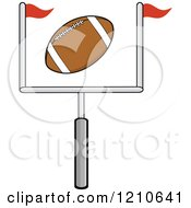 Cartoon Of An American Football Flying Over A Goal Royalty Free Vector Clipart