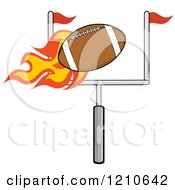 Cartoon Of A Flaming American Football Flying Over A Goal Royalty Free Vector Clipart