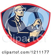 Clipart Of A Retro Truck Driver Behind The Wheel In A Shield Crest Royalty Free Vector Illustration