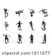 Clipart Of Black Silhouetted Skateboarders 2 Royalty Free Vector Illustration by AtStockIllustration