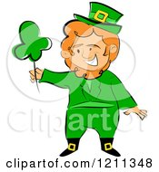 Cartoon Of A St Patricks Day Leprechaun Holding Up A Shamrock Royalty Free Vector Clipart