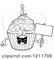 Cartoon Of A Black And White Birthday Cupcake Mascot Holding A Sign Royalty Free Vector Clipart