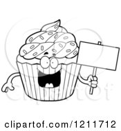 Cartoon Of A Black And White Sprinkled Cupcake Mascot Holding A Sign Royalty Free Vector Clipart