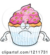 Cartoon Of A Depressed Sprinkled Cupcake Mascot Royalty Free Vector Clipart by Cory Thoman