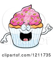 Cartoon Of A Smart Sprinkled Cupcake Mascot With An Idea Royalty Free Vector Clipart by Cory Thoman