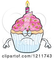 Cartoon Of A Depressed Birthday Cupcake Mascot Royalty Free Vector Clipart by Cory Thoman