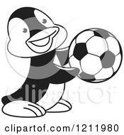 Clipart Of A Black And White Happy Penguin Playing Soccer Royalty Free Vector Illustration