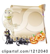 Cartoon Of A Halloween Mummy Pointing To A Scroll Sign With Pumpkins Black Cats And A Broomstick Royalty Free Vector Clipart