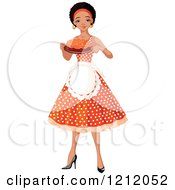 Pretty Black African American Woman An Apron And Polka Dot Dress Holding A Cake
