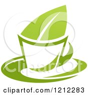 Clipart Of A Cup Of Green Tea Or Coffee And A Leaf 7 Royalty Free Vector Illustration