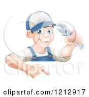 Poster, Art Print Of Happy Brunette Worker Man Holding A Wrench And Pointing Down To A Sign