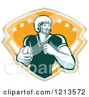 Clipart Of A Retro American Football Player Runningback With A Ball Over A Shield Of Rays And Stars Royalty Free Vector Illustration