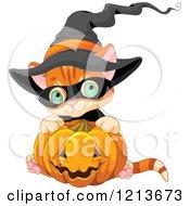 Cute Orange Halloween Kitten Wearing A Witch Hat And Hugging A Pumpkin