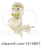 Clipart Of A Happy Halloween Mummy Looking Around And Pointing To A Sign Royalty Free Vector Illustration