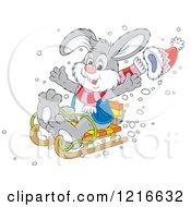 Clipart Of A Happy Rabbit Sledding Royalty Free Vector Illustration