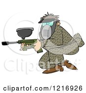 Man In Camo Crouching With A Paintball Gun