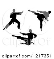 Clipart Of Black Silhouetted Karate And Martial Arts Men Royalty Free Vector Illustration by AtStockIllustration