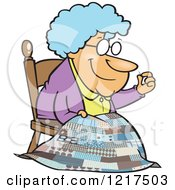 Clipart Of A Cartoon Granny Making A Quilt Royalty Free Vector Illustration