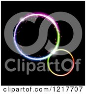Clipart Of Colorful Neon Rings On Black Royalty Free Vector Illustration