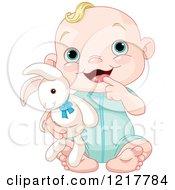 Cute Happy Baby Boy Holding A Stuffed Bunny Rabbit
