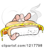 Hand Holding A Mustard Topped Hot Dog