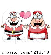 Clipart Of A Santa And Mrs Claus Couple Holding Hands Under A Heart Royalty Free Vector Illustration by Cory Thoman