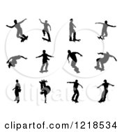 Clipart Of Black Silhouetted Skateboarders 4 Royalty Free Vector Illustration by AtStockIllustration