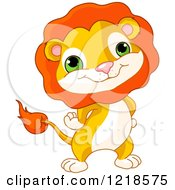 Clipart Of A Cute Baby Lion Standing With His Hands On His Hips Royalty Free Vector Illustration by Pushkin