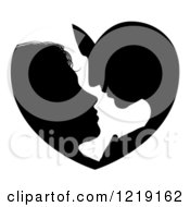 Clipart Of A Silhouetted Couple Forming A Heart As They Lean In For A Kiss Royalty Free Vector Illustration
