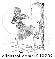 Retro Clipart Of A Vintage Black And White High School Girl With Her Arms Full Of Books Kicking A Full Locker Shut Royalty Free Vector Illustration by Picsburg