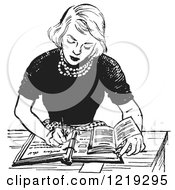 Retro Clipart Of A Black And White Vintage Teenage Girl Doing Homework At A Desk Royalty Free Vector Illustration
