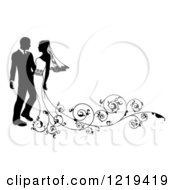 Clipart Of A Black And White Silhouetted Wedding Couple With Ornate Swirls 3 Royalty Free Vector Illustration