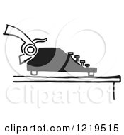 Retro Clipart Of A Black And White Retro Typewriter And Page Royalty Free Vector Illustration