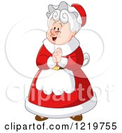 Mrs Claus Clasping Her Hands Together