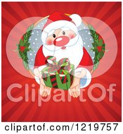 Clipart Of Santa Reaching Out Of A Hole And Holding A Gift Through Rays Royalty Free Vector Illustration
