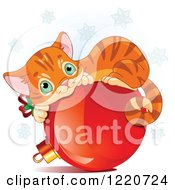 Clipart Of A Cute Ginger Cat Resting On A Christmas Bauble Under Snowflakes Royalty Free Vector Illustration