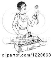 Clipart Of A Black And White Retro Woman Opening A Box Of Tulips Royalty Free Vector Illustration