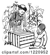 Black And White Boys Looking In An Animal Trap In A Corn Field