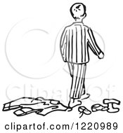 Black And White Boy In Pjs Walking Away From Clothes
