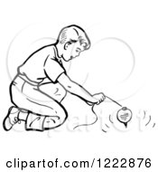 Clipart Of A Retro Boy Playing With A Top In Black And White Royalty Free Vector Illustration by Picsburg