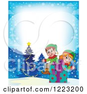 Clipart Of A Winter Border With Christmas Elves Sitting On A Present In The Snow Royalty Free Vector Illustration