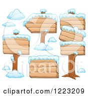 Clipart Of Wooden Winter Signs With Snow Royalty Free Vector Illustration by visekart